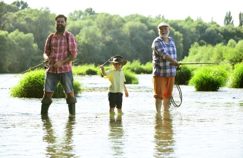 grandpa dad and son fishing in a lake