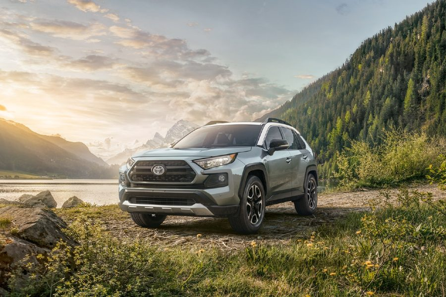 2020 Toyota RAV4 light blue exterior front fascia driver side parked near forest mountain lake