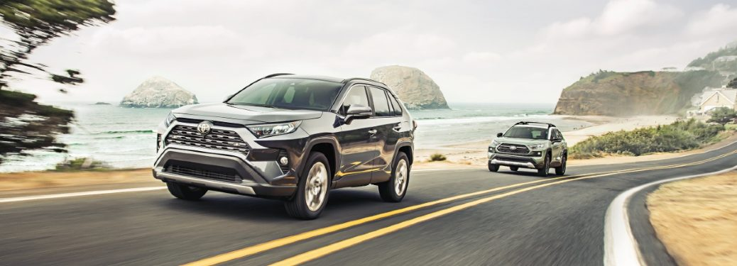 two rav4 models on a road