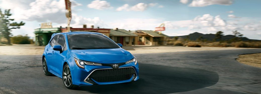 2021 Toyota Corolla Hatchback driving down a rural road