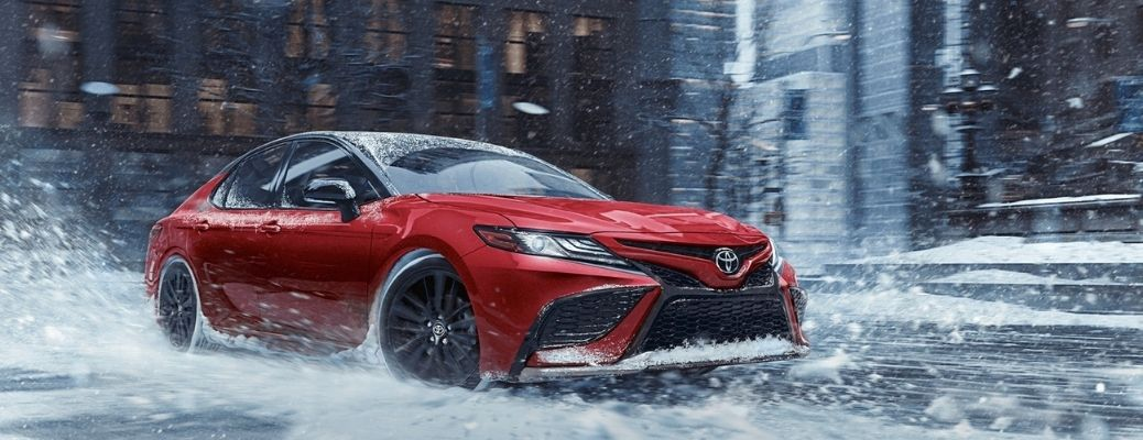2021 Toyota Camry driving on snow
