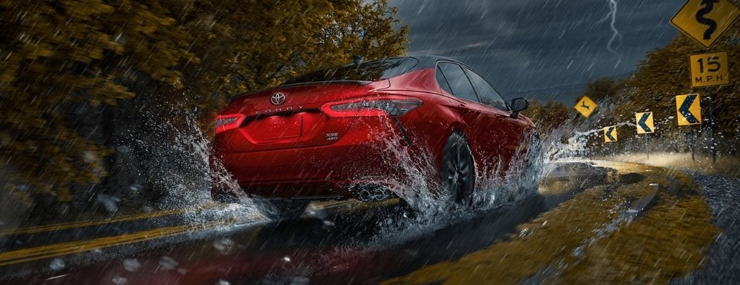 2021 Toyota Camry driving on rain covered road