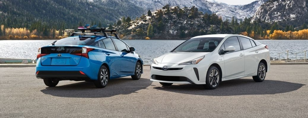 Two 2021 Toyota Prius' parked side by side