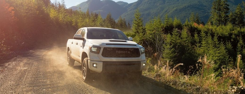 2021 Toyota Tundra driving front view on dirt