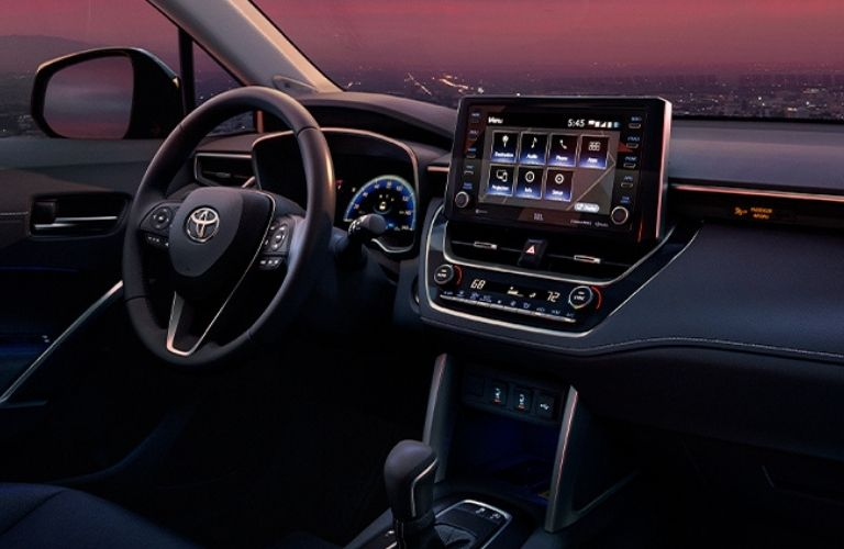 View of the infotainment system and the steering wheel of the 2022 Toyota Corolla Cross