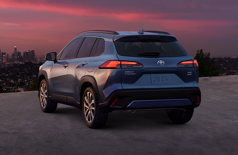 Back view of the 2022 Toyota Corolla Cross overlooking the skyline
