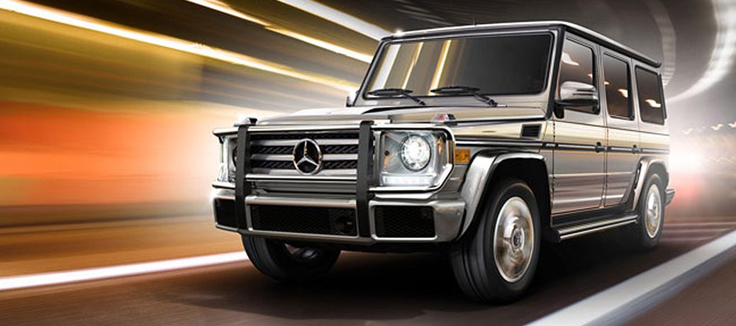 Gray 2018 Mercedes-Benz g-class driving through a tunnel with blurred lights.