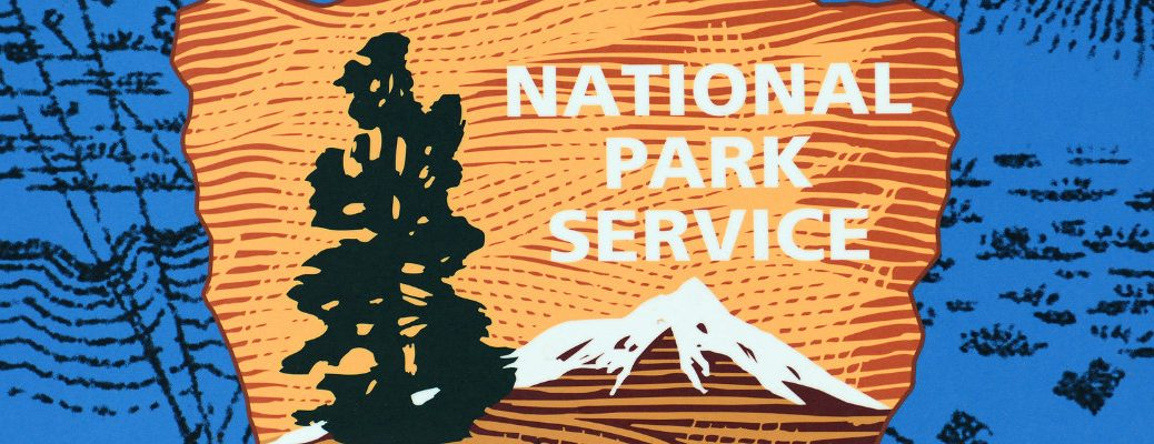 Close up of the National Park Symbol with a tree and an arrowhead