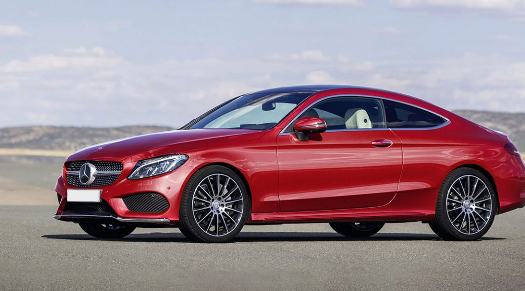 2017 red Mercedes-Benz parked by the water