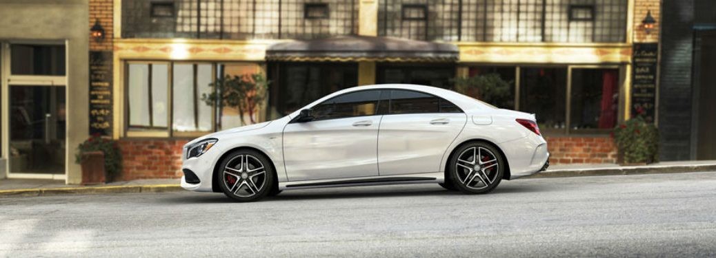 Driver side view of a white 2018 Mercedes-Benz CLA