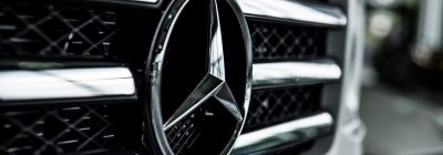 Close-up on the Mercedes-Benz logo on a vehicle's grille