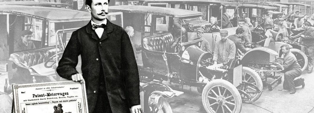 """Karl Benz stands proudly with his """"Patent Motorwagen"""" sign"""