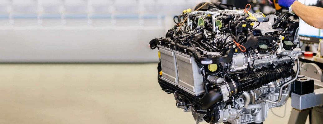 Mercedes-AMG engine held by a hand