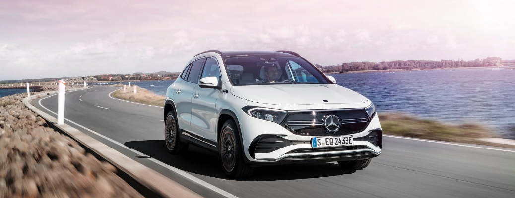 White 2021 Mercedes-Benz EQA drives up a highway