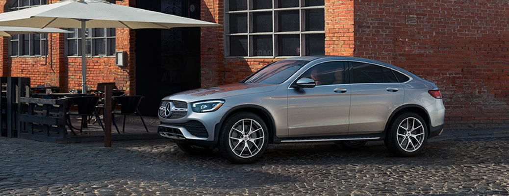2021 Mercedes-Benz GLC Coupe parked by a giant umbrella.