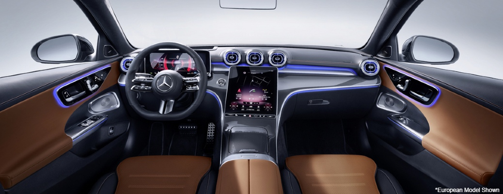 """Wide view of front cockpit of 2022 Mercedes-Benz C-Class. Text reads, """"European Model Shown"""""""