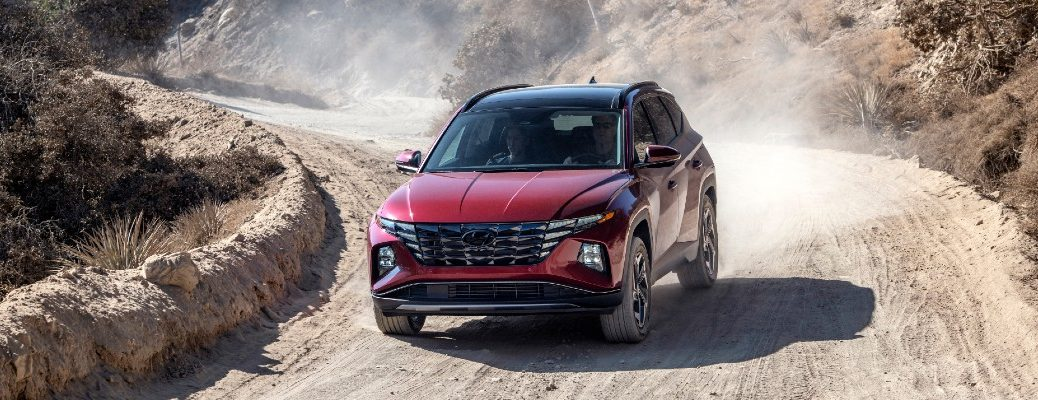 A photo of the 2022 Hyundai Tucson on a gravel road.