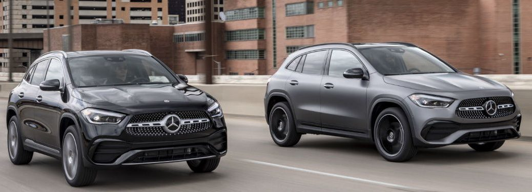Two 2021 Mercedes-Benz GLA driving down a city road