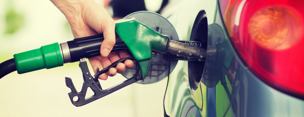 A stock photo of a person filling up their vehicle with gasoline.