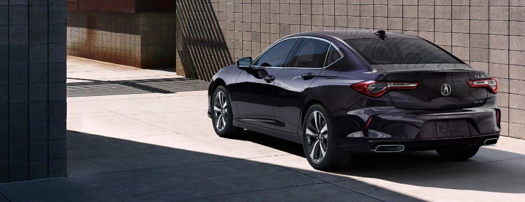 A rear left quarter photo of the 2021 Acura TLX.