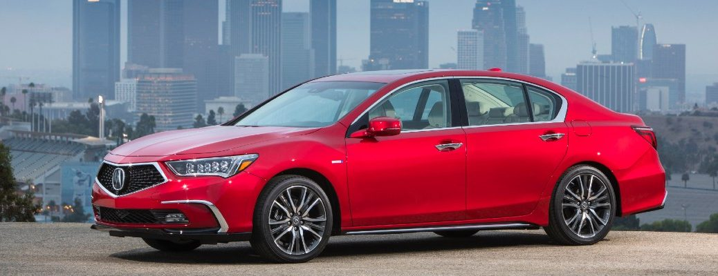 A photo of an Acura sedan parked in front of a skyline.