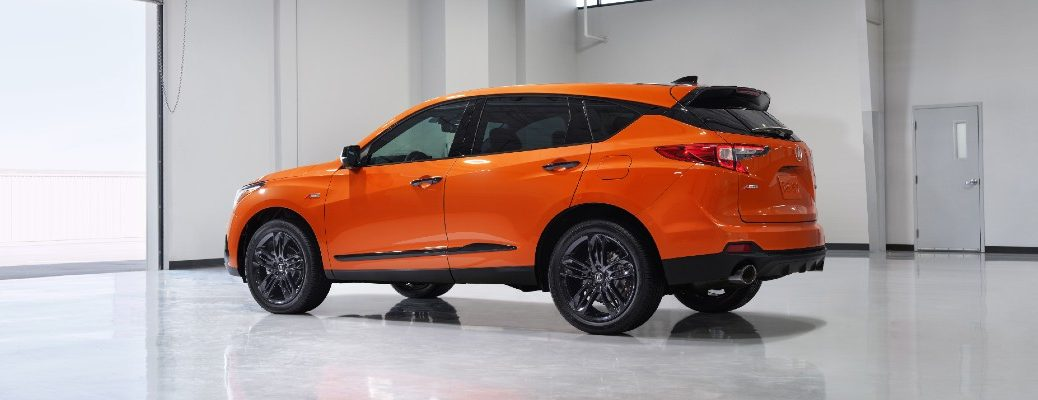 A left profile photo of the 2021 Acura RDX in an aircraft hangar.