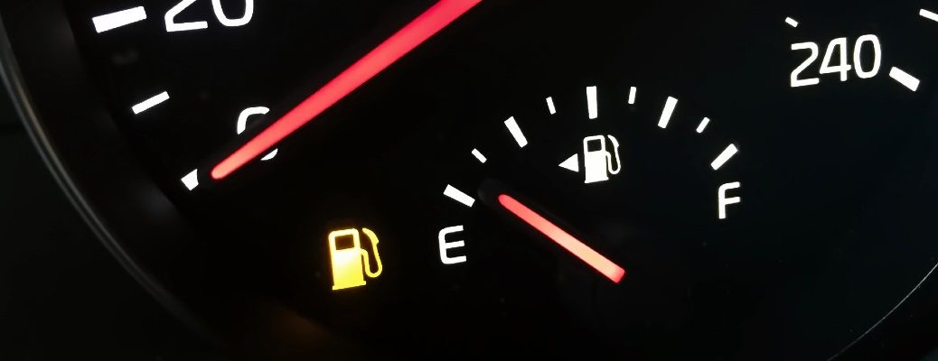 A stock photo of a gas gauge pointing to empty.