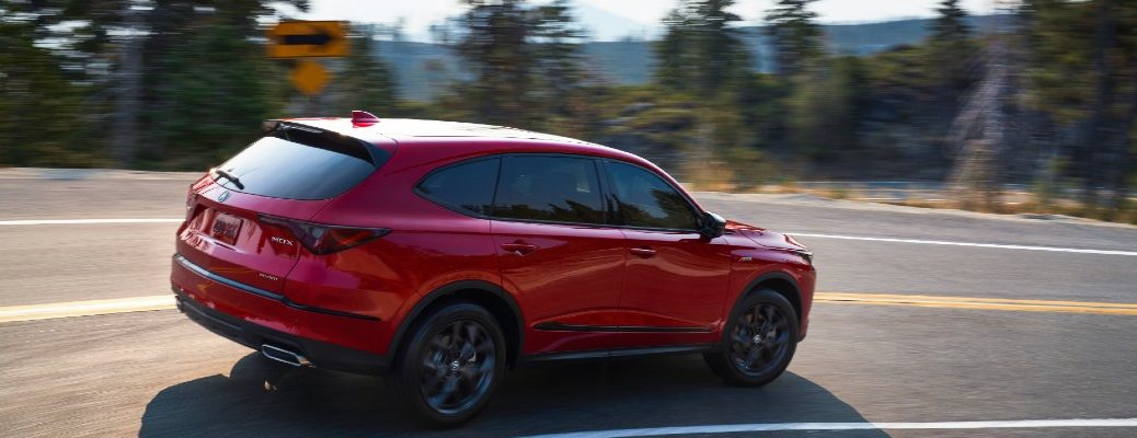 A right profile photo of the 2022 Acura MDX in motion on the road.