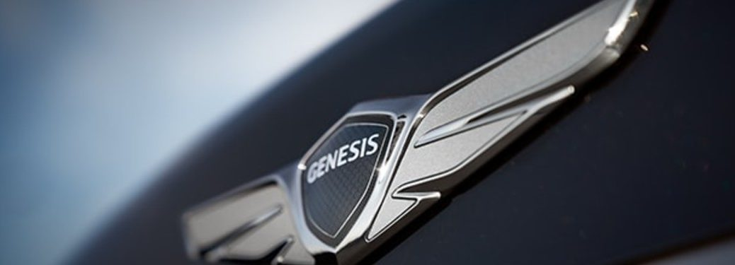 close up of Genesis badge on a car