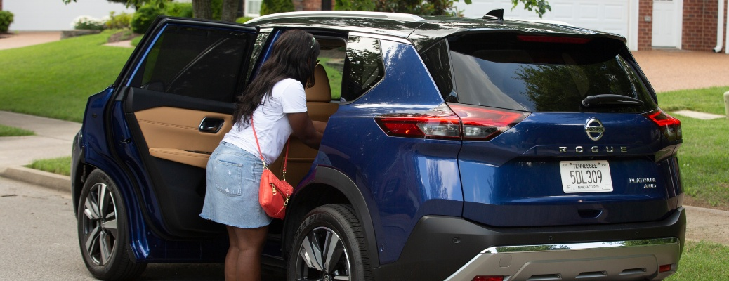 2021 Nissan Rogue with RDA and woman reaching into the back seat