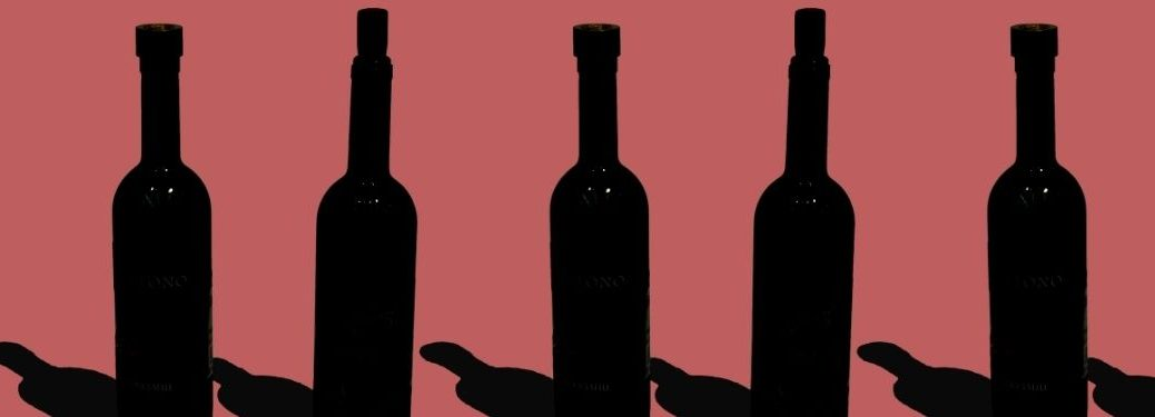 wine bottles blacked out on pink background