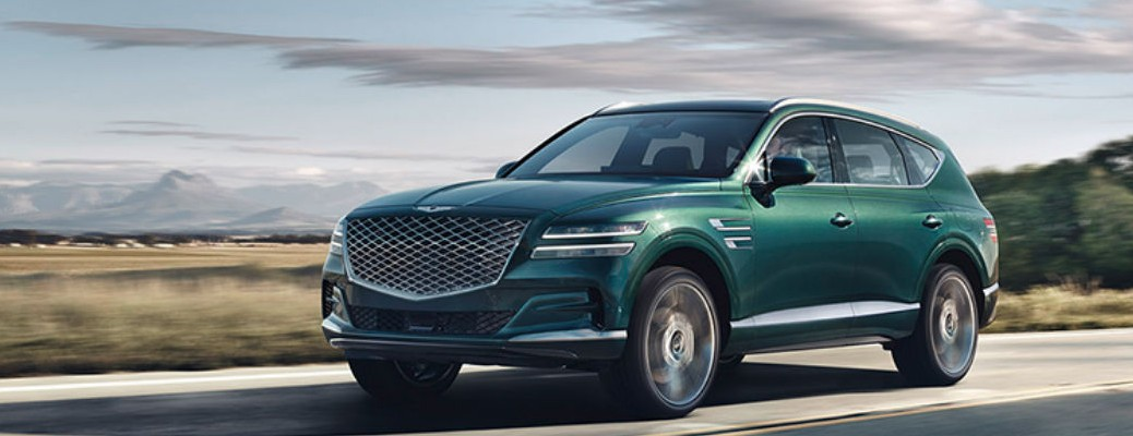 2021 Genesis GV80 green driving on highway