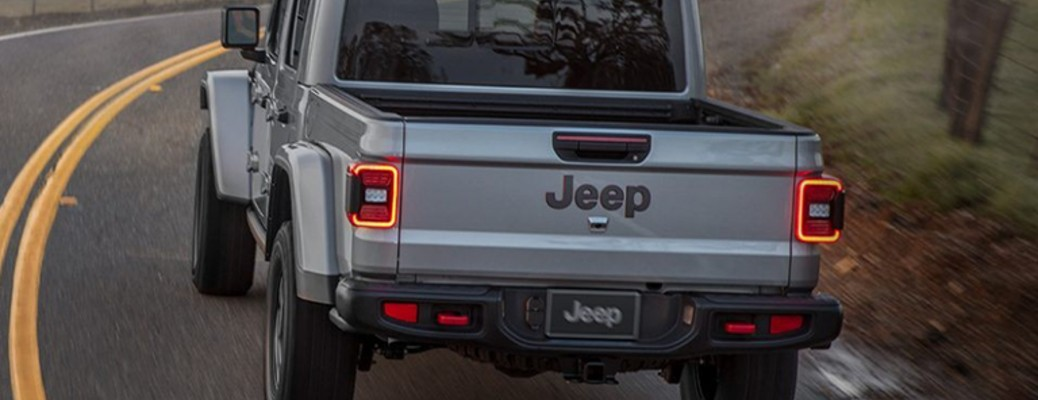 A 2021 Jeep Gladiator driving on a curved road