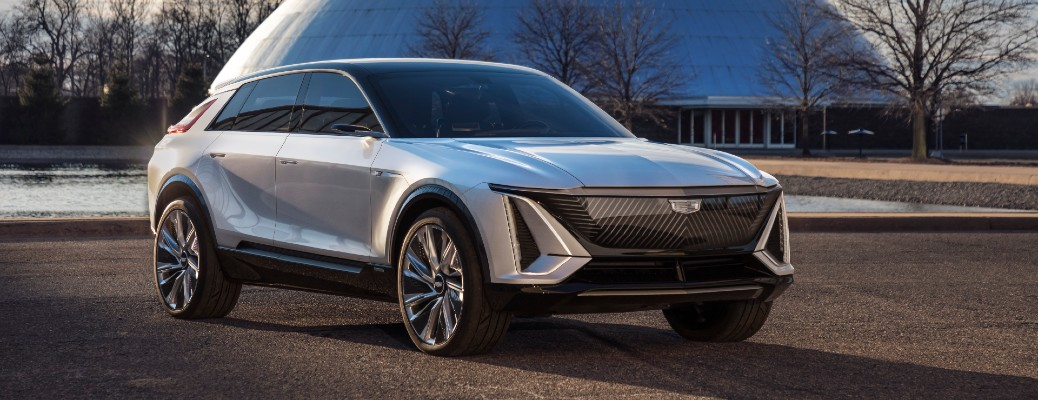 2023 Cadillac LYRIQ EV SUV model exterior shot parked on a grass field in front of a dome building