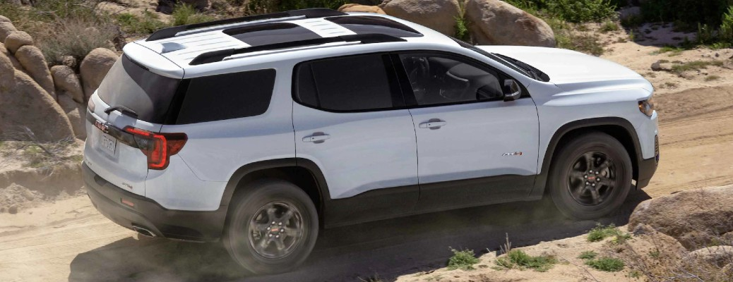 2021 GMC Acadia AT4 exterior overhead shot driving on a desert dirt road