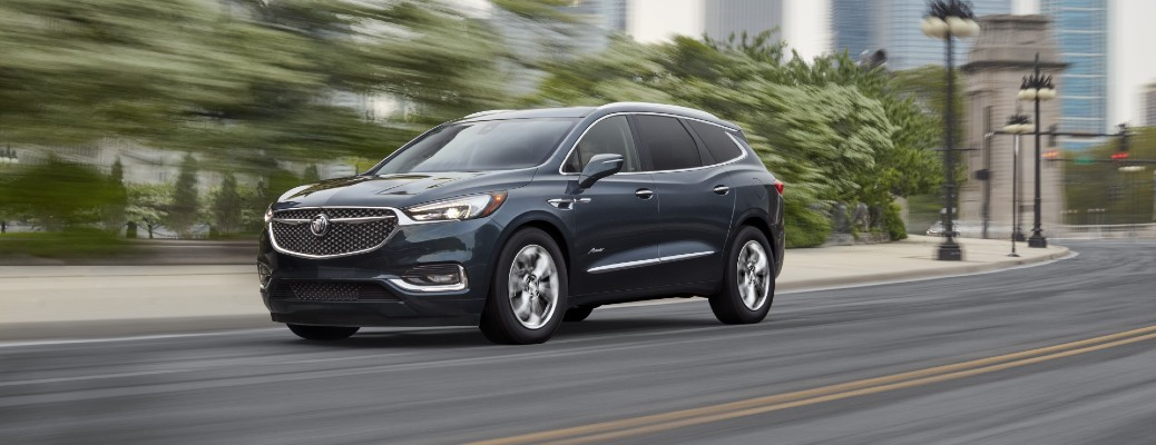 2021 Buick Enclave exterior shot driving past foliage and street lamps as the background blurs