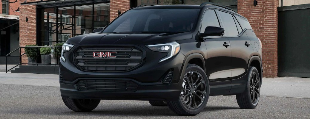 2021 GMC Terrain Elevation Edition with Ebony Twilight paint color parked in front of a brick building