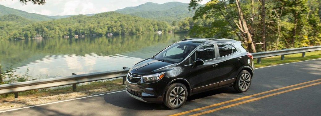2021 Buick Encore driving on a road by water