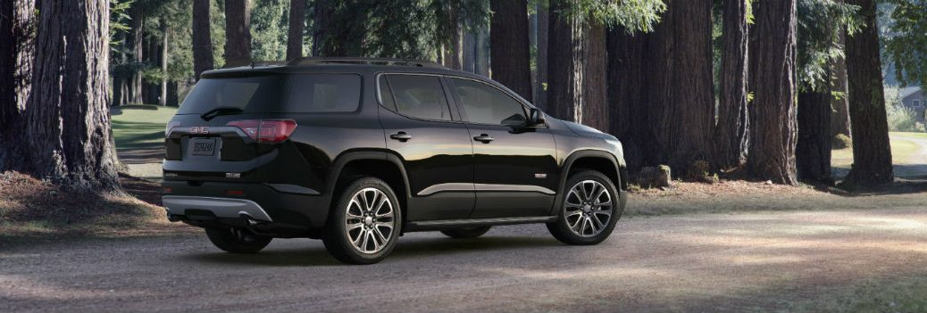 2021 GMC Acadia parked in a lot in the woods