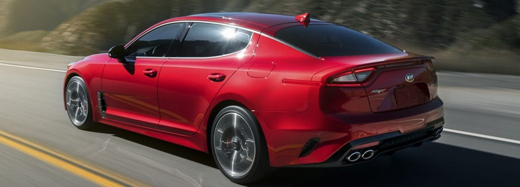 Rear side view of a red 2019 Kia Stinger
