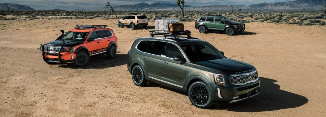 Four 2020 Kia Telluride models parked in sand