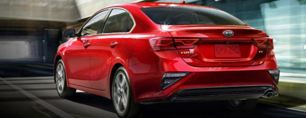 2021 Kia Forte Currant Red moving on the road