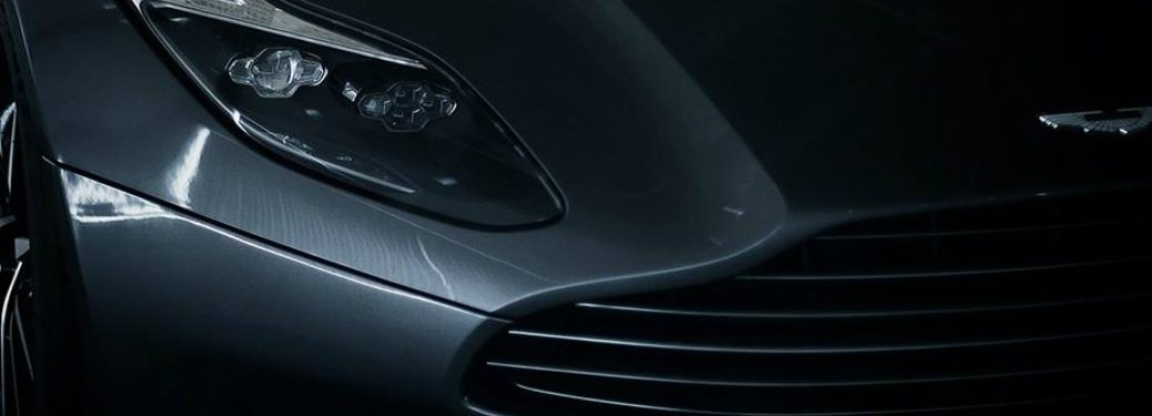 gray Aston Martin in the dark