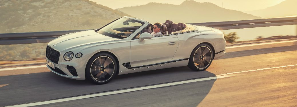 white bentley continental gt convertible on a mountain top road