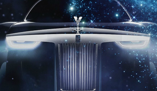 closeup of futuristic rolls-royce grille and headlights with spirit of ecstasy hood ornament