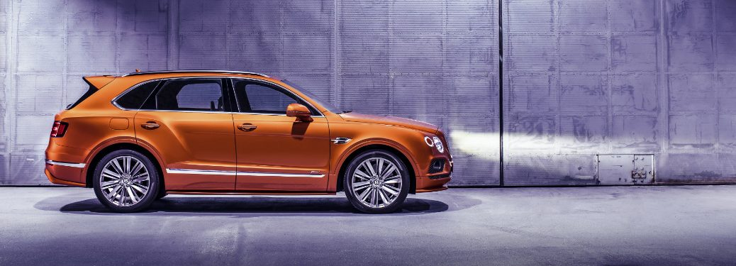 orange Bentley Bentayga Speed side view