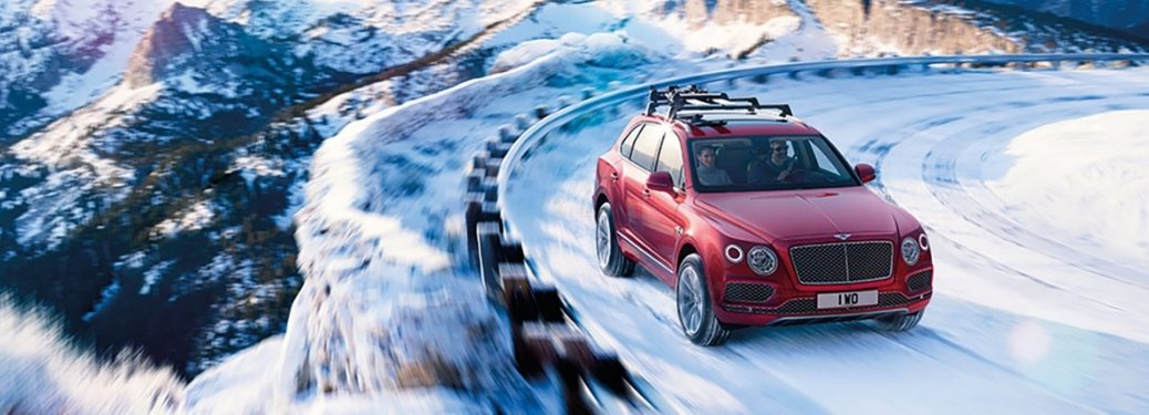 Red 2019 Bentley Bentayga on a Snowy Mountain Road