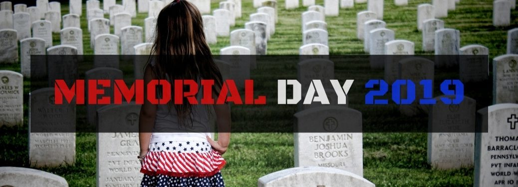 Little Girl Standing in a Military Cemetery on Memorial Day with Black Rectangle Text Box and Red, White and Blue Memorial Day 2019 Text