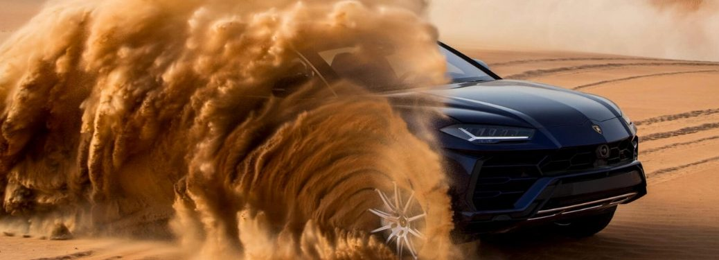 Black 2019 Lamborghini Urus Kicking Up Sand in the Desert