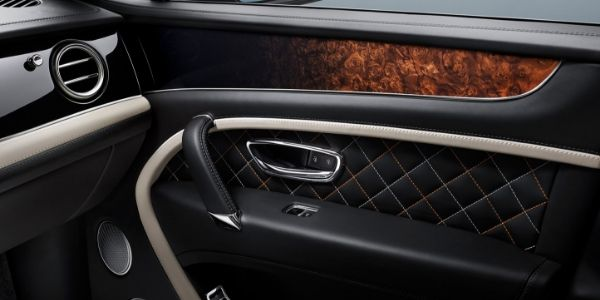 Close Up of 2019 Bentley Bentayga Leather and Wood Door Trim